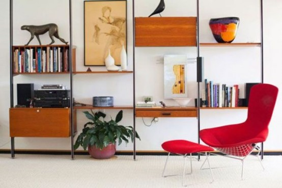 a mid-century modern wall unit with drawers and cabinets, open shelves and a bookshelf