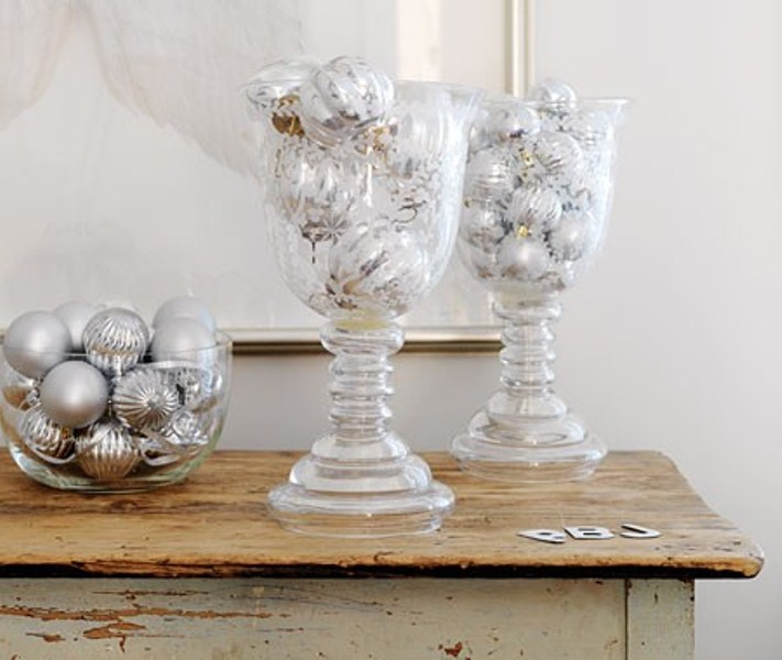 frosted glass jars and a bowl with silver ornaments are nice to decorate tables, shelves, a mantel and other places