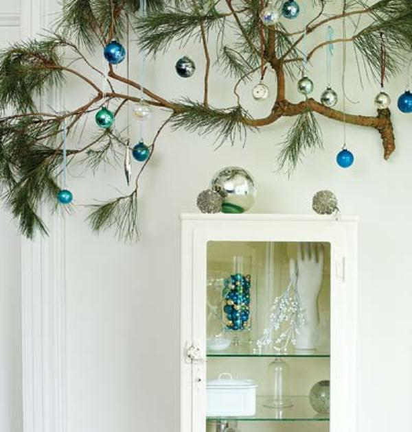 attach a branch and hang some Christmas ornaments on it to make your space more festive and bright