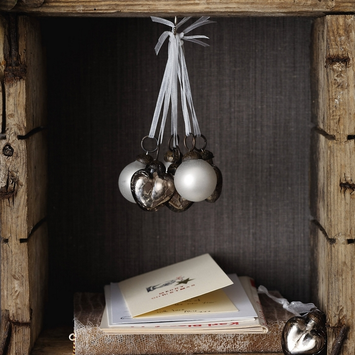an arrangement of white and silver ornaments for Christmas is a chic and stylish idea to accent even a small nook