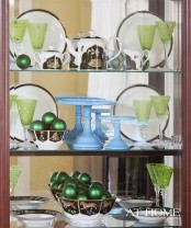 emerald Christmas ornaments in bowls are amazing to make the decor bolder and more holiday-like