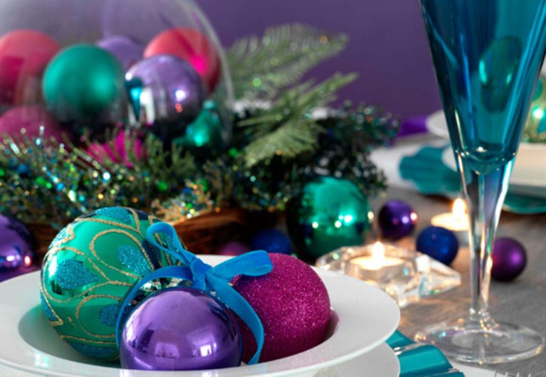 place some colorful Christmas ornaments into bowls and cloches to make your tablescape bolder and whimsier