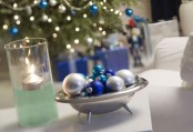 a silver bowl with silver, blue and turquoise ornaments can be used as a decoration or as a centerpiece