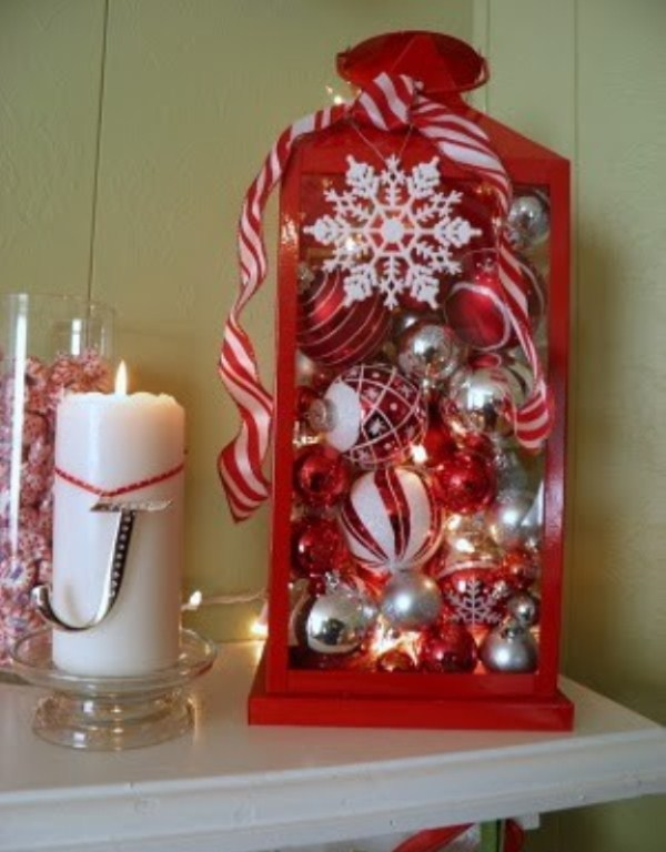 a red lantern filled with white, red and silver ornaments plus snowflakes for simple and cute Christmas decor