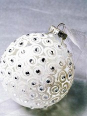 a frosted glass Christmas ornament with beads is a cool idea for winter wonderland home decor