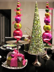 colorful Christmas ornament topiaries and a sparkling green sequin Christmas tree cone