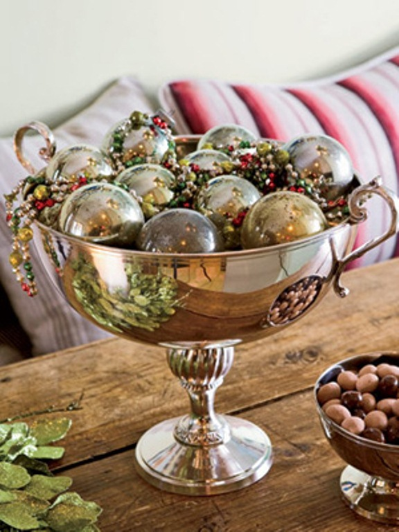 a vintage silver bowl with matching Christmas ornaments and colorful beads is a nice and elegant Christmas centerpiece