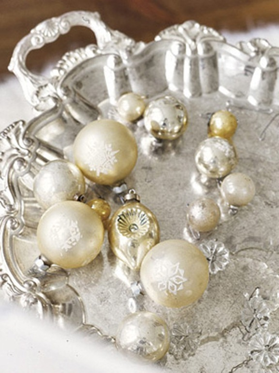 a silver tray with silver and gold ornaments is a chic decoration, you may add evergreens and candles for a more festive feel