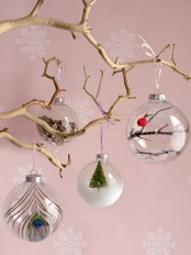 grab sheer glass ornaments and fill them with whatever you like – feathers, mini trees, faux snow and so on to create a cool combo