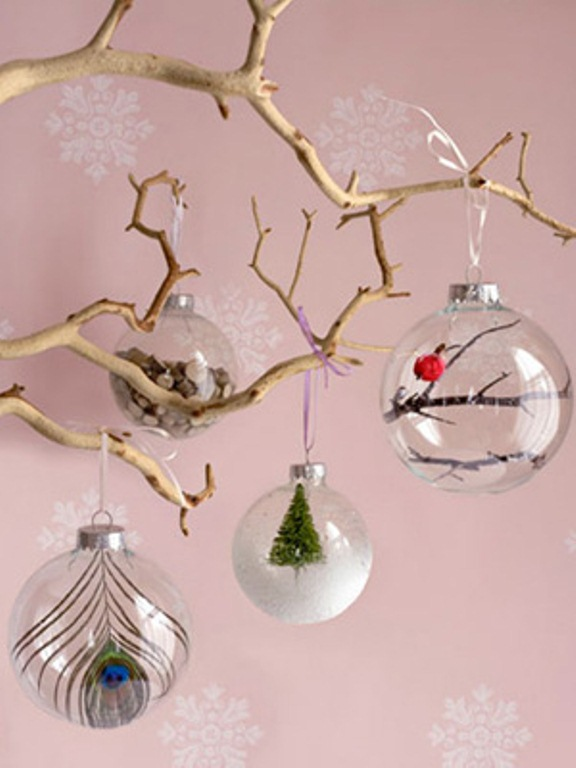 grab sheer glass ornaments and fill them with whatever you like   feathers, mini trees, faux snow and so on to create a cool combo
