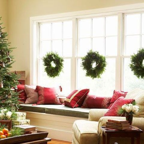 Classic Christmas wreaths looks better in multiples, especially if your window is actually a combination of several windows.