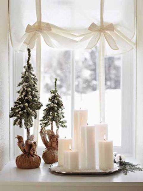 A bunch of candles and several little faux Christmas trees covered with faux snow would look great on any windowsill.