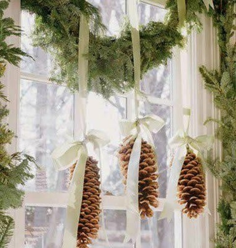 Pinecones are great for different kinds of Christmas decorations and looks especially good on hung from an evergreen swag framing a window.