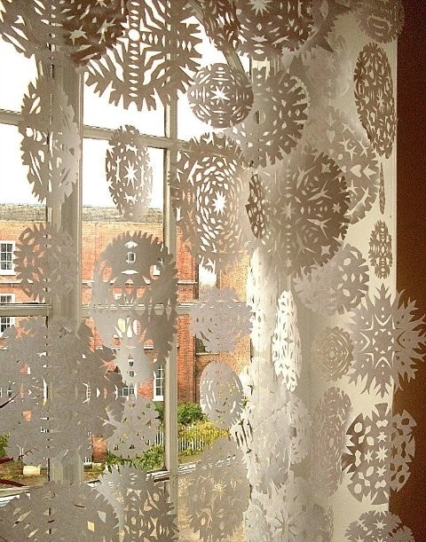 snowflakes cut of paper is the cheapest way to decorate your windows and a really cool