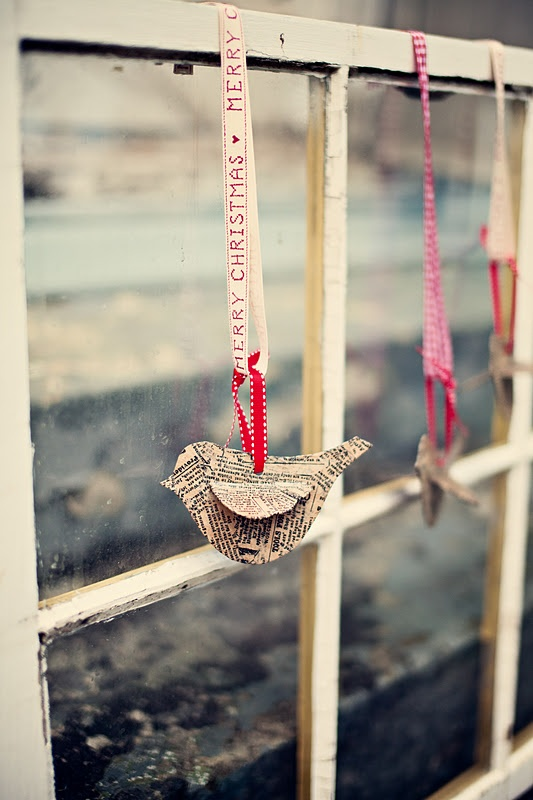 For a vintage, rustic touch cut something cool from old newspapers and hang it on a window.