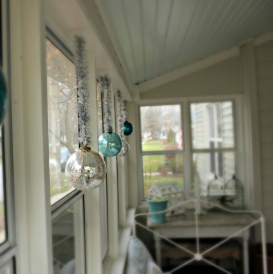 Transparent glass ornaments hung in windows will catch light and send reflections throughout the room.