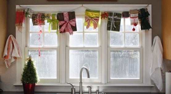 Make a garland of old Christmas presents and fix it on top of a window.