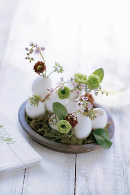 Lily Of The Valley And Lisianthus In Eggs On Moss