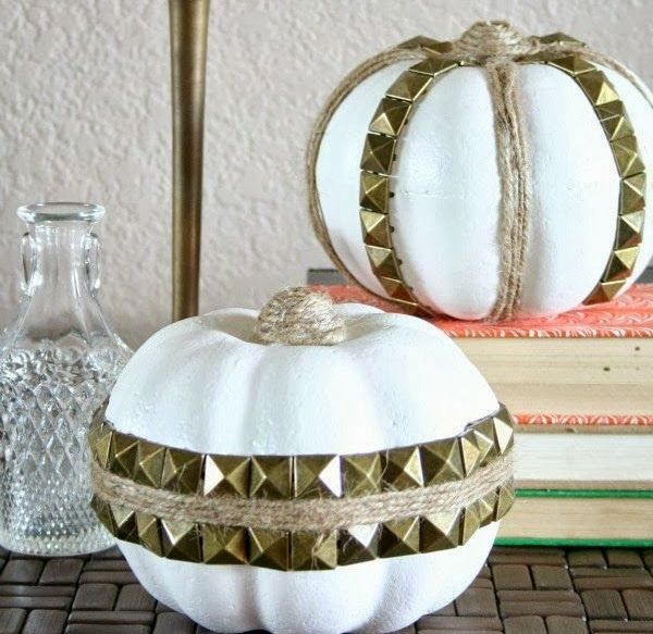 white faux pumpkins with twine and gold spikes attached look fun,, rock and glam and will add an edgy touch to the space