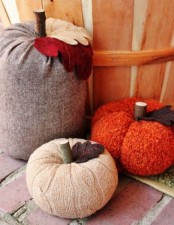 bright and neutral fabric pumpkins with stems and felt leaves are fun and cool for fall decor