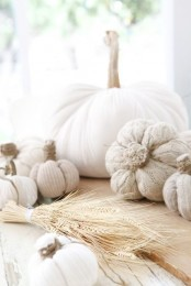 white fabric pumpkins of various fabric including knit and crochet are stylish and ethereal decorations for the fall