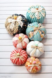 colorful fabric pumpkins of bright printed fabric, with lace ribbons and bright buttons are amazing for fun fall decor