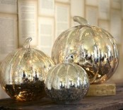 mercury glass pumpkins will bring a shiny glam touch to the space and a vintage feel at the same time