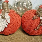 orange knit fabric pumpkins with newspaper leaves and twine stems are chic and stylish and will bring a bright touch to the space