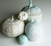 faux white and light blue pumpkins, painted in various patterns and with beads look refined and very elegant