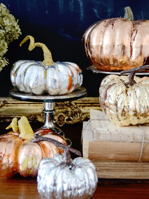 faux pumpkins spruced up with copper, gold and silver leaf are amazing to add a shiny and chic touch to the space