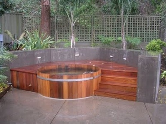 If you don't want an in-ground hot tub then don't forget to add stairs to yours. They will help you to get in without any troubles.