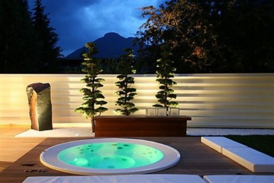 An outdoor Jacuzzi tub is a great addition to your backyard if the climate isn't too harsh.