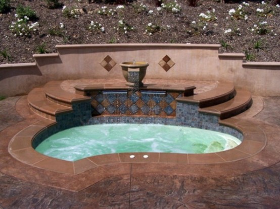Maroccan tiles is a great idea to decorate your garden hot tub.