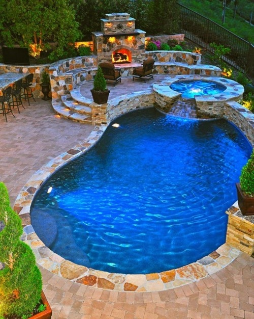 patio with an inground hot tub jacuzzi and a fireplace could make