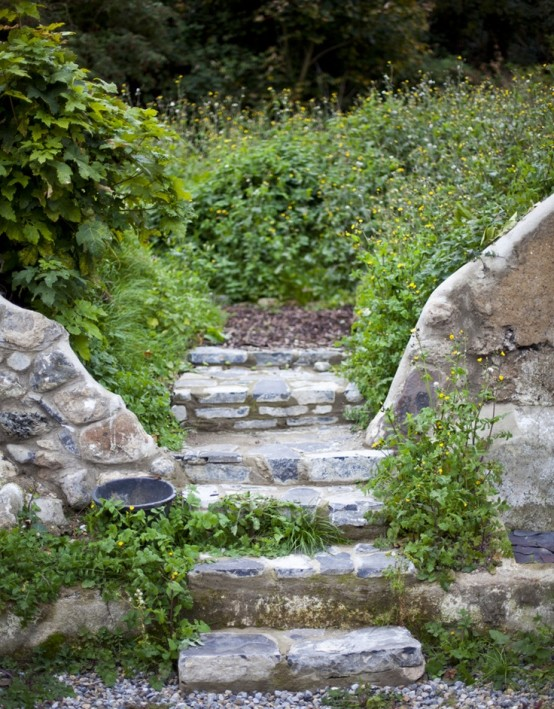 stone steps with pebble pathways and greenery growing here and there make the space look cooler