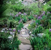 a stone and pebble garden path like this one looks very natural and casual, and will fit most of gardens