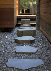 gravel and stones of various sizes, height and shapes add interest to the neutral and minimalist garden