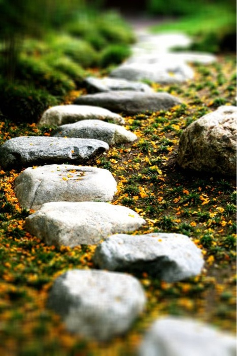 a rough and small stone garden path with sand around is a cool idea with a natural feel though walking on it isn't very comfortable
