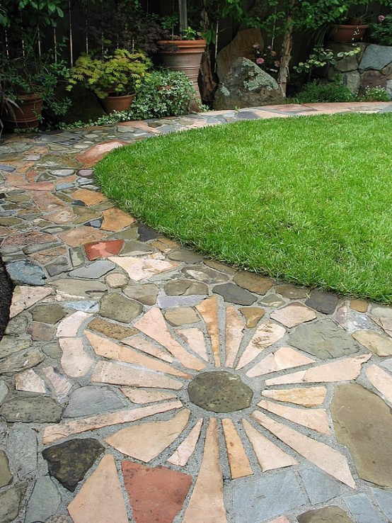 a creative stone and concrete garden pathway looks catchy and fits a casual and simple garden