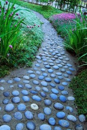 a sand and stone pathway in your garden contrasts the bright blooms, and though it's harder to walk on it, it looks pretty