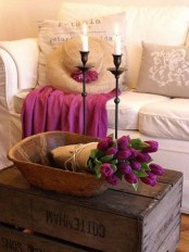 a wooden bowl with purple tulips in kraft paper is a pretty centerpiece or decoration