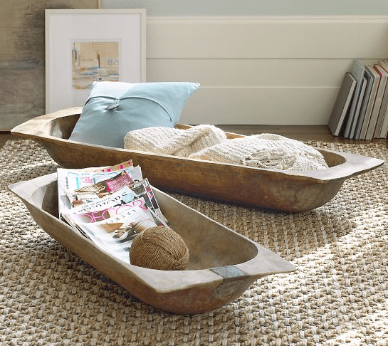 antique dough bowls used for storing pillows, blankets and magazines in a rustic home