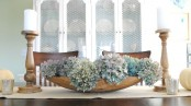 a dough bowl with blue hydrangeas is a stylish famrhouse centerpiece that can be DIYed in a minute