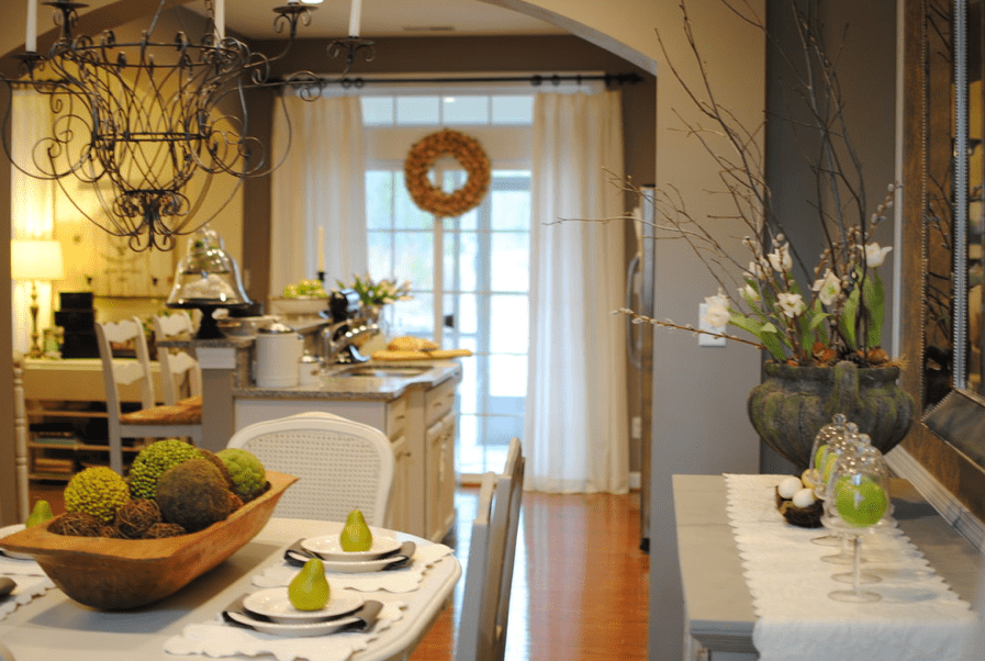 a rustic centerpiece of a dough bowl and moss and vine balls for a rustic home