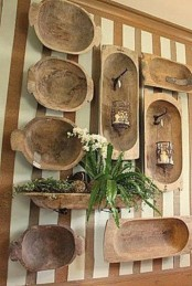 a whole wall covered with antique dough bowls, and a bowl used as a planter