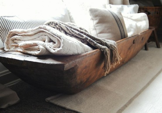 storing towels and pillows in a dough bowl is a cool and simple idea with a rustic feel