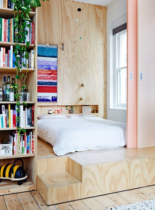 a plywood platform and a matching headboard wall with a niche is a contemporary solution