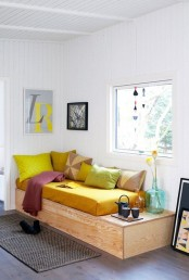 a platform bed is easy to build and hides some storage space