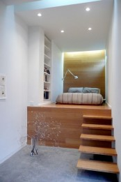 a tall platform to highlight the sleeping space and hide much storage space under the bed