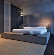 a platform substitutes a usual bed giving much storage space around and some hidden storage space inside